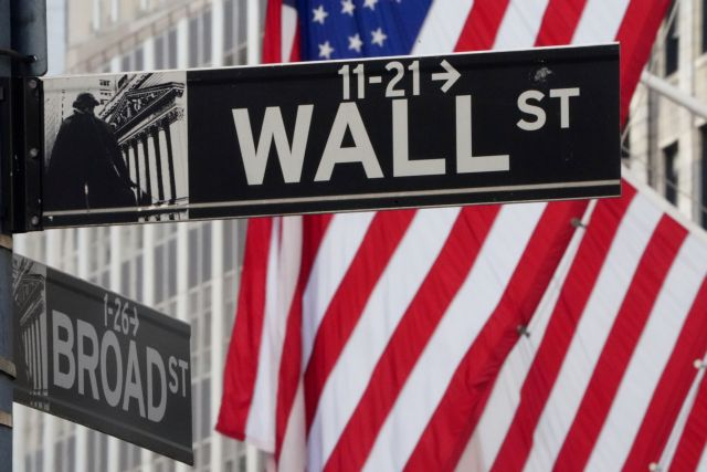 FILE PHOTO: The Wall Street sign is pictured at the New York Stock exchange (NYSE) in the Manhattan borough of New York City, New York, U.S., March 9, 2020. REUTERS/Carlo Allegri/File Photo