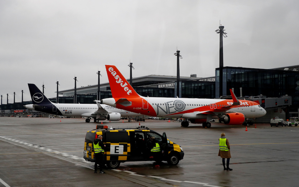FILE PHOTO: A Lufthansa aircraft and an EasyJet aircraft are seen after landing at Terminal 1, marking the official opening of the new Berlin-Brandenburg Airport (BER)