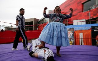 Silvana La Poderosa, a cholita wrestler, reacts after winning a fight during their return to the ring after the coronavirus disease (COVID-19) restrictions, in El Alto outskirts of La Paz, December 6, 2020. Picture taken December 6, 2020. REUTERS/David Mercado