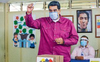 O πρόεδρος της Βενεζουέλας, Νικολάς Μαδούρο, εδραίωσε την ηγεμονία του χάρη στη νίκη του κόμματός του στις βουλευτικές εκλογές της Κυριακής (φωτ. A.P. / Ariana Cubillos).