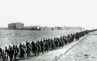 Column of Italian prisoners is on the march under British guard, after the fall of Sidi Barrani. Ruins of the Italian base in Egypt are in background, December 29, 1940. The desert base fell to the British and more than 10,000 prisoners. (AP Photo)