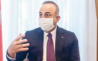 Σκληρή γραμμή στο ζήτημα του Κυπριακού τήρησε ο Μεβλούτ Τσαβούσογλου, από την Πορτογαλία. (Φωτ. EPA/Mariscal)