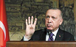 Σύμφωνα με έρευνα της τουρκικής εταιρείας δημοσκοπήσεων ΚΟΝDA, τα ποσοστά της κυβερνητικής συμμαχίας του AΚP του Ταγίπ Ερντογάν με το MHP αγγίζουν τo 49,6% (φωτ. Turkish Presidency via A.P., Pool).