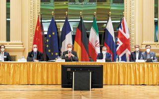 Οι εκπρόσωποι του Ιράν και των άλλων χωρών που εξακολουθούν να δεσμεύονται από τη συμφωνία (Βρετανία, Γαλλία, Γερμανία, Ρωσία, Κίνα) είχαν μια πρώτη, προπαρασκευαστική συνάντηση σε ξενοδοχείο της Βιέννης χθες το πρωί (φωτ. EU Delegation in Vienna/Handout via REUTERS).