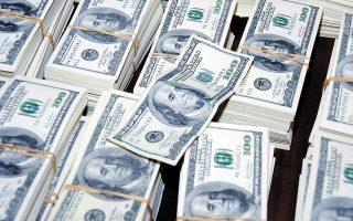 Το δολάριο επηρεάστηκε από αμφίσημες δηλώσεις στελεχών της Fed περί αναδίπλωσης του προγράμματος αγοράς τίτλων.