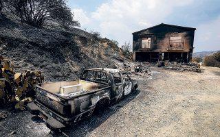 Η μεγαλύτερη καταστροφή από το 1974 μέχρι σήμερα στην Κύπρο θεωρείται η πυρκαγιά που έπληξε το νησί και άφησε πίσω της τέσσερις νεκρούς και μεγάλες καταστροφές σε καλλιέργειες και δασικές εκτάσεις. Η πυρκαγιά, για την οποία συνελήφθη ένας 67χρονος, κατασβέστηκε πλήρως χθες το πρωί και αρχίζει το δύσκολο έργο καταγραφής ζημιών (φωτ. A.P. Photo / Petros Karadjias).