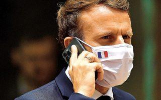 Ο Γάλλος πρόεδρος Εμανουέλ Μακρόν, στο πλαίσιο του Pegasus, πρώτα άλλαξε αριθμό στο κινητό του και μετά κάλεσε το Συμβούλιο Ασφαλείας της χώρας του (φωτ. John Thys, Pool Photo via AP).