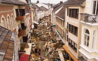 Οι πλημμύρες στη Γερμανία, ο καύσωνας που έπληξε τις ΒΔ ΗΠΑ και οι δασικές πυρκαγιές σε Ελλάδα, Ιταλία και Τουρκία, στο μικροσκόπιο της ερευνητικής ομάδας WWA (φωτ. A.P. Photo / Bram Janssen).