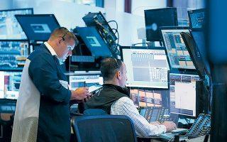 Αργά χθες το βράδυ πριν από το κλείσιμο της αμερικανικής αγοράς οι Dow Jones και S&P 500 εμφάνιζαν κέρδη της τάξεως του 0,43% και 0,34% αντιστοίχως (φωτ. A.P.).