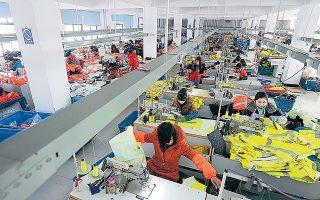 Η τόνωση της αρωγής προς τις μικρομεσαίες επιχειρήσεις από την κινεζική κυβέρνηση φανερώνει την ανησυχία της για τις προοπτικές ανάπτυξης (φωτ. EPA).