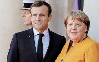 Εναν κύκλο σταθερότητας 16 ετών κλείνει η επίσκεψη της Αγκελα Μέρκελ στο Παρίσι, η οποία θα είναι η τελευταία πριν από τις βουλευτικές εκλογές της 26ης Σεπτεμβρίου (φωτ. A.P. Photo/Kamil Zihnioglu).